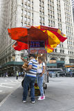 Vendor sells hot dogs and pretzels on the street in new york cit Stock Photo