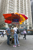 Vendor sells hot dogs and pretzels on the street in new york cit Royalty Free Stock Photo