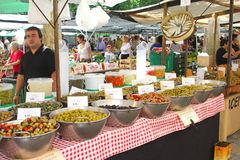 Vendor Sells Mediterranean Olives And Tapas At The Market In Pollenca, Mallorca, Spain Stock Photos