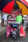 Vendor sells Muar Chee on the street in Penang, Malaysia. PENANG, MALAYSIA-29 DECEMBER, 2016: Vendor sells Muar Chee on the street in Penang, Malaysia. Muah Chee stock photo