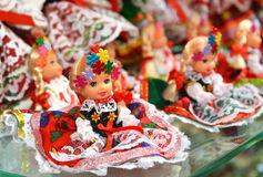 Vendor sells Polish traditional handicraft souvenirs in Sukiennice (Cloth Hall). Royalty Free Stock Photography
