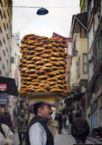 A vendor sells simit, a type of Turkish bread, in the streets of Stock Image