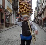 A vendor sells simit, a type of Turkish bread, in the streets of Royalty Free Stock Image