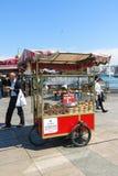 A vendor sells simits on a street o Stock Images