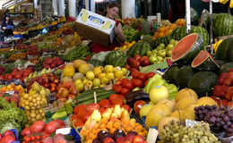 Vendor sells vegetables at the market Royalty Free Stock Images