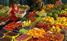 Vendor sells vegetables at the market Stock Image