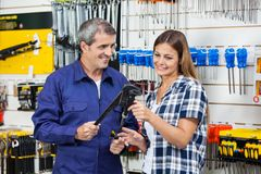 Vendor Showing Pliers To Female Customer Royalty Free Stock Photography
