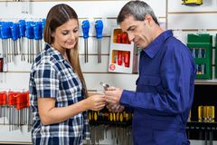 Vendor Showing Wrench To Customer In Shop Stock Photos
