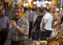 Vendor Smoking in istanbul Spice Market Royalty Free Stock Photography