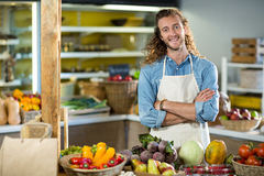 Vendor standing at the counter with arms crossed Royalty Free Stock Photography