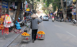 Vendor on the street in Hanoi old town Stock Photo
