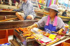 Vendor woman at the floating market Stock Photography