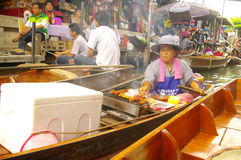 Vendor woman at the floating market stock photo
