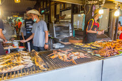 Vendors are cooking some food at Amphawa floating market Stock Photos