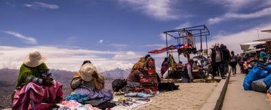 Vendors at El Alto Market. El Alto, Bolivia on October 1, 2015: Vendors at El Alto Market overlooking La Paz, one of the world`s biggest markets. The women Stock Image