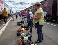 Vendors of food products are waiting for customers while parking a train at the railway station Petrozavodsk royalty free stock image