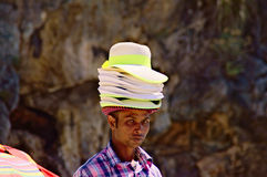 Vendors,hat,portrait. Beach vendors attempt to organize the sale of its articles colored. Summer 2014 city of marine camerota in Campania Italy Stock Photos