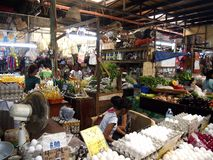 Vendors inside a public market sell a wide variety of fresh and raw food. ANTIPOLO CITY, PHILIPPINES - JUNE 21, 2016: Vendors inside a public market sell a wide Royalty Free Stock Images