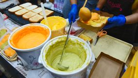 Vendors making Thai flavoured custard toast for sale in a local market. stock video