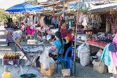 Vendors at a roadside hill tribe market, Chiang Rai province, Thailand. Chiang Rai, Thailand - December 10th 2014: Vendors at a roadside hill tribe market. The stock image