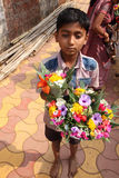 Vendors sell flowers in front of a temple Royalty Free Stock Image