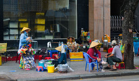 Vendors sell foods on street in Saigon, Vietnam Stock Photo