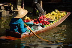 Vendors selling fruit boating on the canal. Royalty Free Stock Images