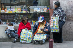 Vendors selling lottery tickets near Independence Square in Quito in Ecuador in South America. Royalty Free Stock Image