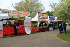 Vendors set up on grounds of Lilac Festival, Rochester, New York, 2017. Vendors set on the grounds of Lilac Festival, with smells wafting in the air, drawing Stock Photo
