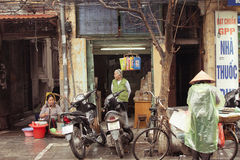 Vendors on the streets of Hanoi, Vietnam. Hanoi, Vietnam - 3 MARCH: Vendors on the streets of Hanoi, March 3, 2014 royalty free stock photo