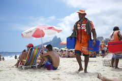 Vendors and Sunbathers on Ipanema Beach Rio Royalty Free Stock Image