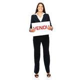 Vendu. Business woman holding vendu sign in hands. Isolated on a white background Royalty Free Stock Photo