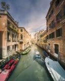 Venecia canal with boats and gondolas, Italy. Street view of Venecia canal with boats and gondolas, Italy Stock Photo