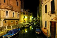 Venecian Night Scene 2. Scenic night shot of a canal in Venice, reflections and boats on the water stock photo