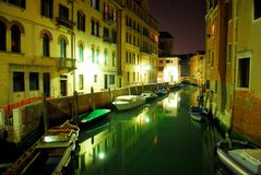 Venecian Night Scene 3. Scenic night shot of a canal in Venice, reflections and boats on the water stock photography