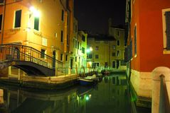 Venecian Night Scene 4. Scenic night shot of a canal in Venice, reflections and boats on the water stock images
