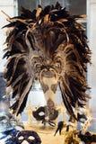 VENEDIG ITALIEN, AUGUSTI 25: Den Venetian karnevalet maskerar till salu.  Arkivbilder