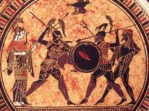 VENEDIG ITALIEN - JULI 02, 2017: Detalj från en gammal historisk grekisk målarfärg över en maträtt Mytiska hjältar och gudar som  arkivbilder