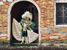 Venice, Italy - March 2, 2019 Person dressed in a typical Venetian Costume models under a arch