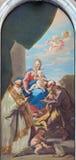 Venedig - oskuld på tronen och St Joseph och st Cesareo av Giovanni Antonio Pellegrini i domkyrka av Santa Maria Assunta Royaltyfri Foto