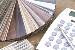 Veneer and calculator. Several samples of inlay with pen and calculator on a wooden table stock images