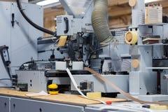 Veneer or edge banding machine at factory Royalty Free Stock Photo