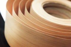 Veneer in a roll. Closeup of veneer in a roll Stock Image