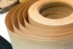 Veneer in a roll. Closeup of veneer material in a roll Stock Photo
