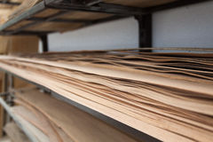 Veneer sheets stored on a shelf Stock Images