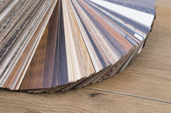 Veneer on table. Several samples of inlay on a wooden table royalty free stock photography