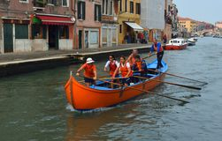 Venetain rowing team on the Cannaregio Canal Venice Italy. VENICE, ITALY - SEPTEMBER 23, 2017: Venetain rowing team on the Cannaregio Canal Venice Italy royalty free stock image