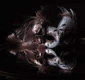 Venetiaanse maskerbezinningen Stock Afbeeldingen