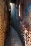Venetian Alley and Graffiti Wall Stock Image