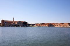 Venetian Arsenal shipyard, canal and industrial red bricks buildings in Venice, Italy. Venetian Arsenal shipyard, canal and industrial red bricks buildings in a stock photos